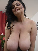 Huge breasted mature lady getting frisky